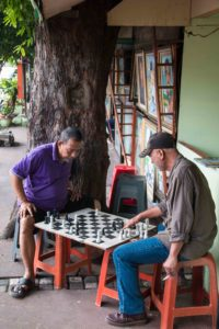 Men playing chess on the streets of Jakarta Indonesia