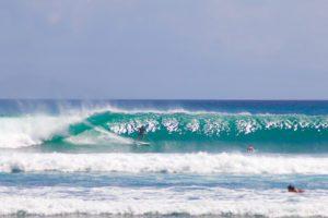 Surfing waves on Balangan Beach Bali