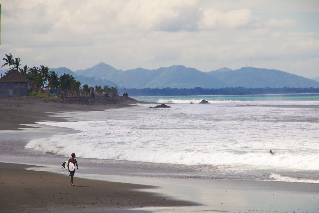 Surfer at Keramas beach in Bali