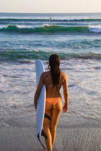 Surf girl on Batu Balong beach Canggu