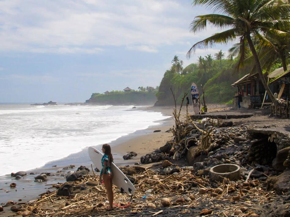 Surfer girl on Balian Beach in Bali