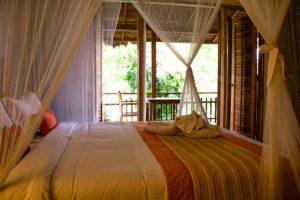 Bed room at Svarga Loka Wellness resort in Ubud