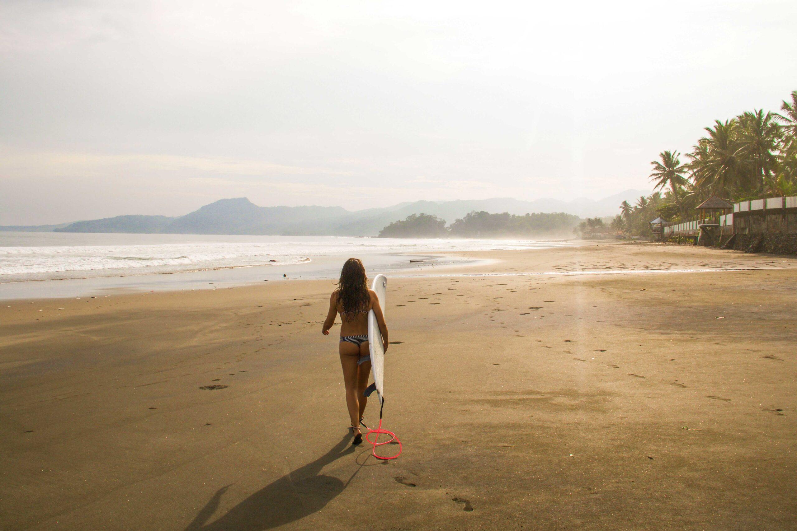 beach sunset surfing cimaja java