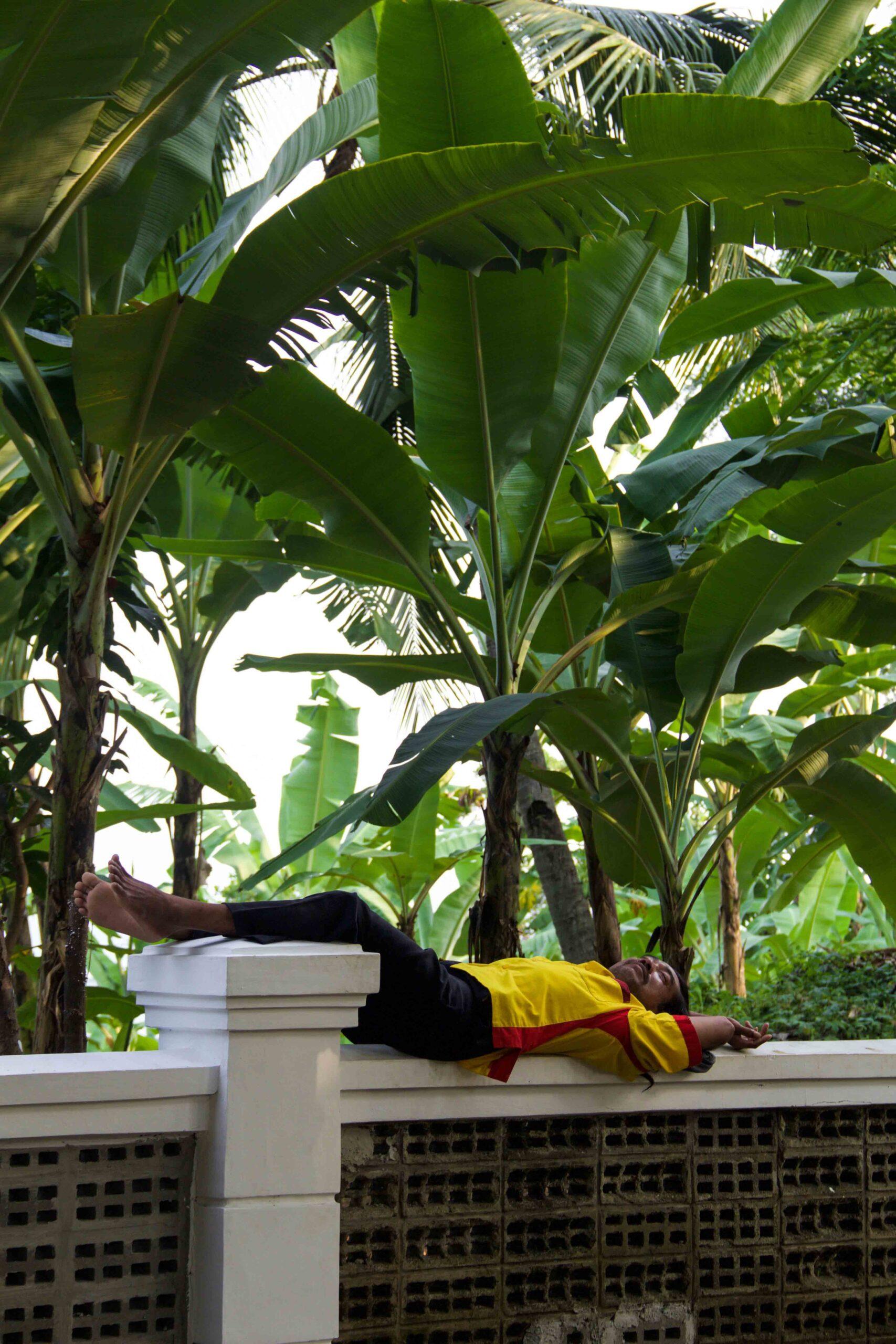 Local man sleeping in Cimaja Java