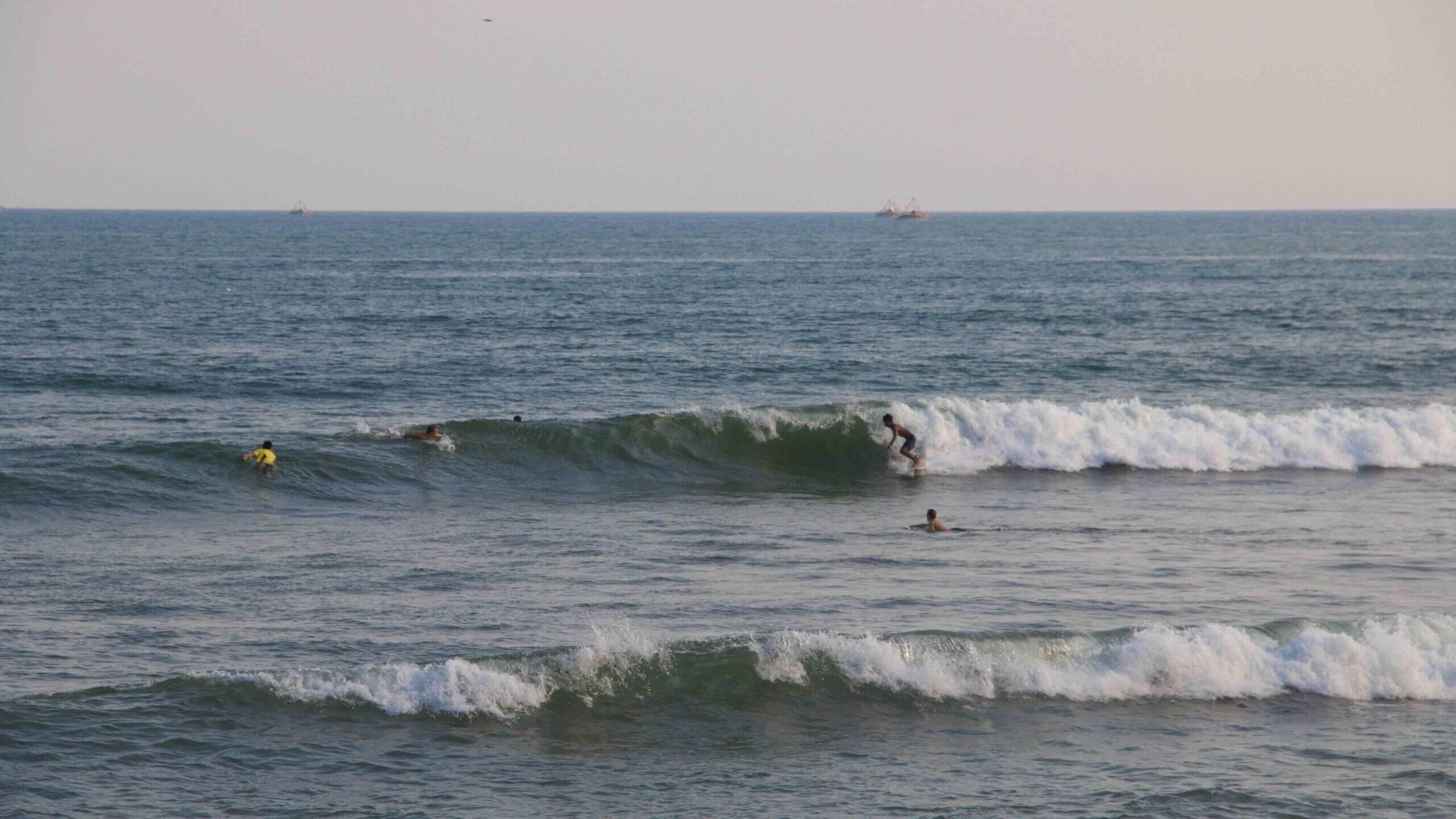 surfing waves in Cimaja Java Indonesia