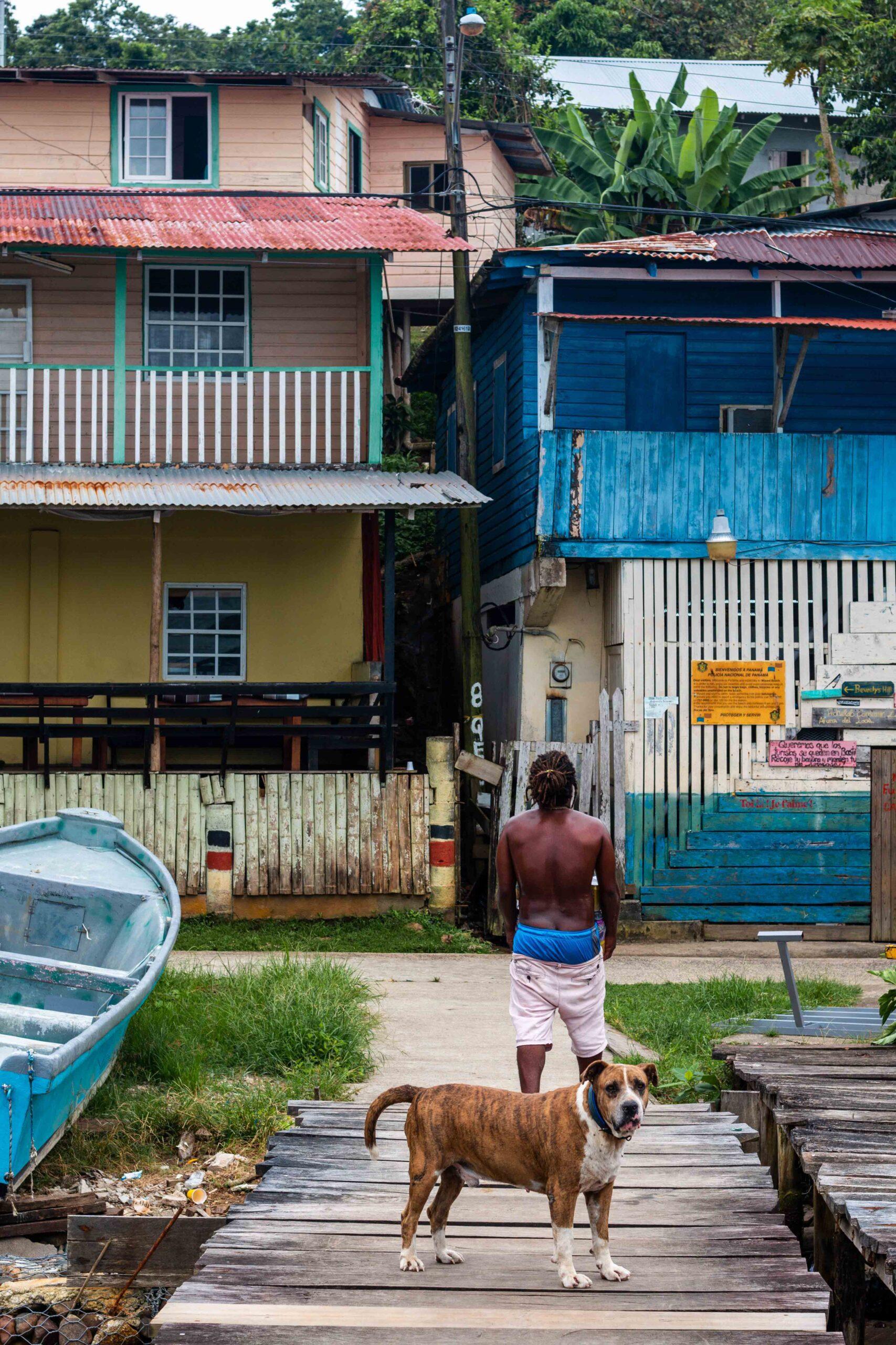 Dog and local man on Isla Bastimentos Bocas del Toro