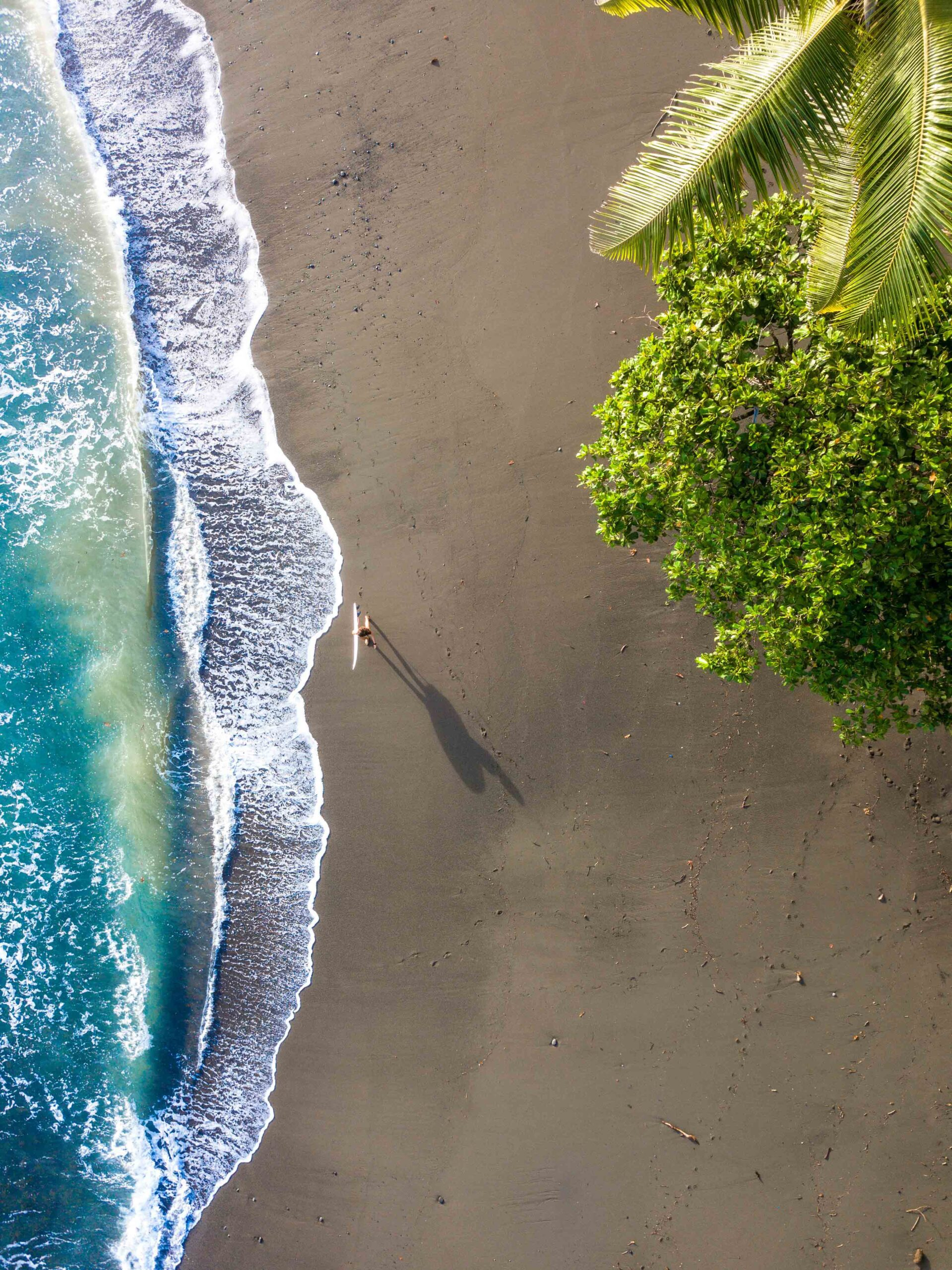Surfer girl on the beach drone shot in Costa Rica