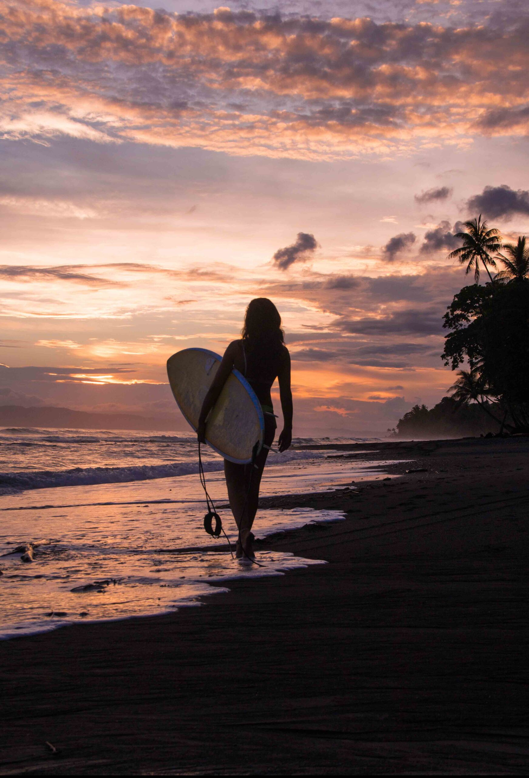 surfer girl sunset Punta Banco Costa Rica