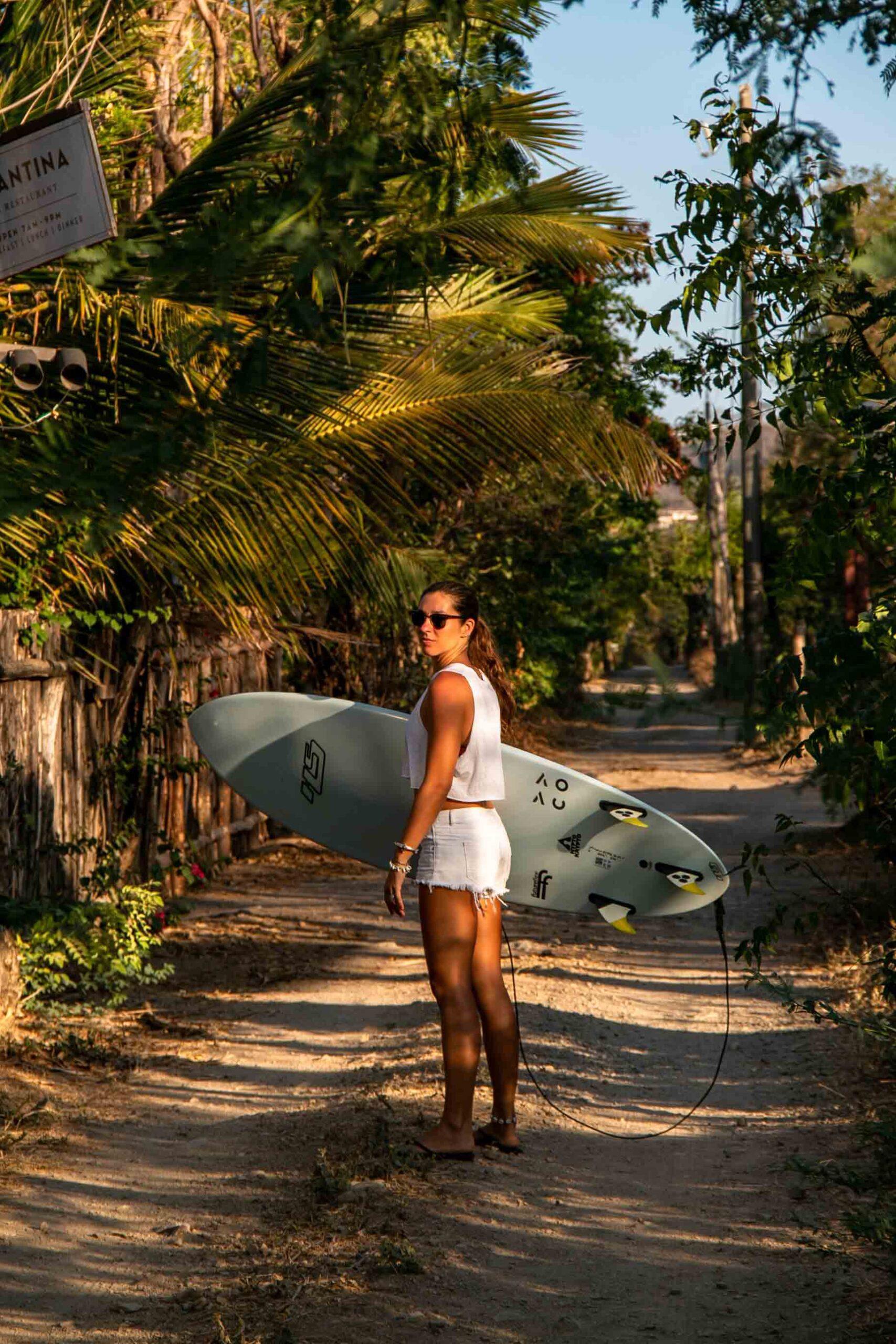 Surf girl at Malibu Popoyo in Nicaragua