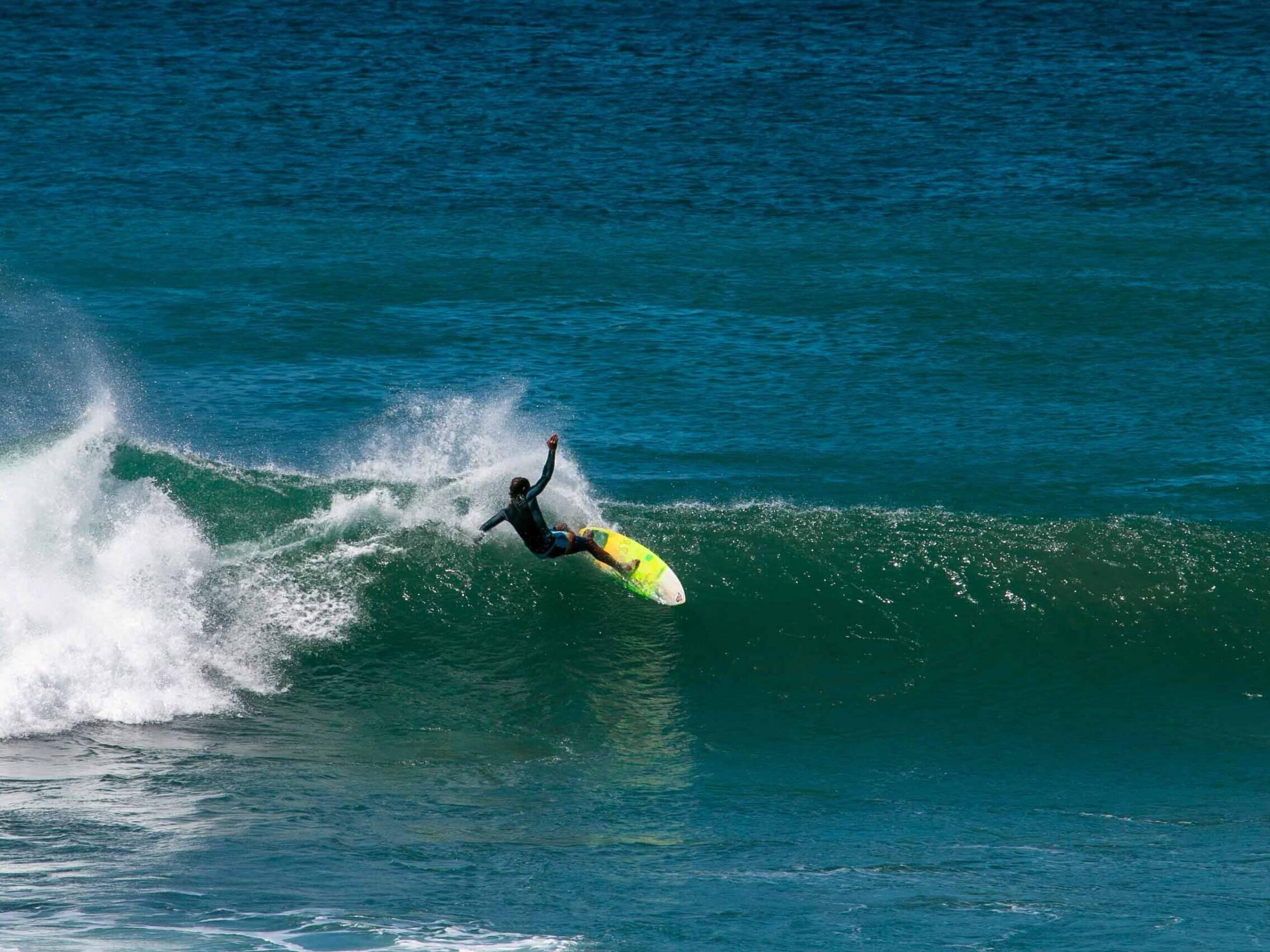 Surfer at Panga Drops at Playa Colorado in Nicaragua