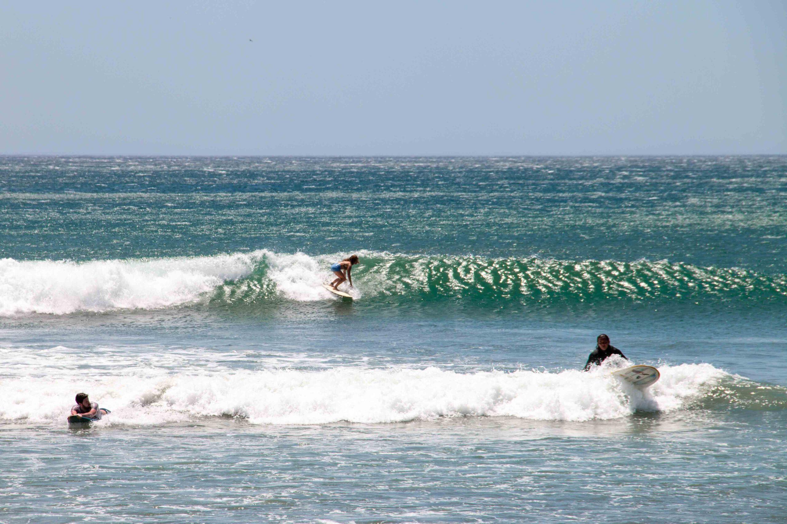 Surfer girl at Playa Maderas in Nicaragua