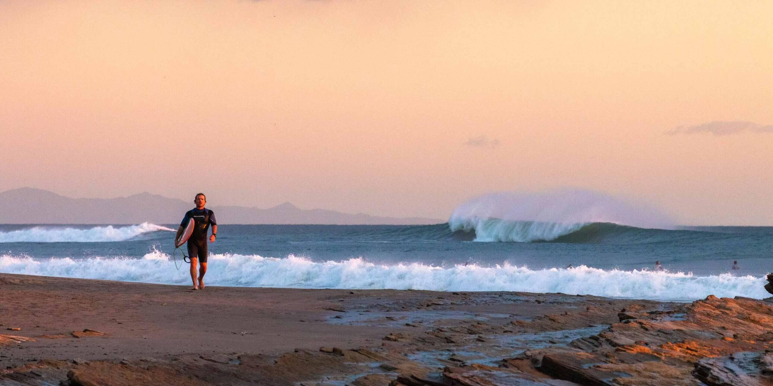 Surfer during sunset at Playa Popoyo Nicaragua