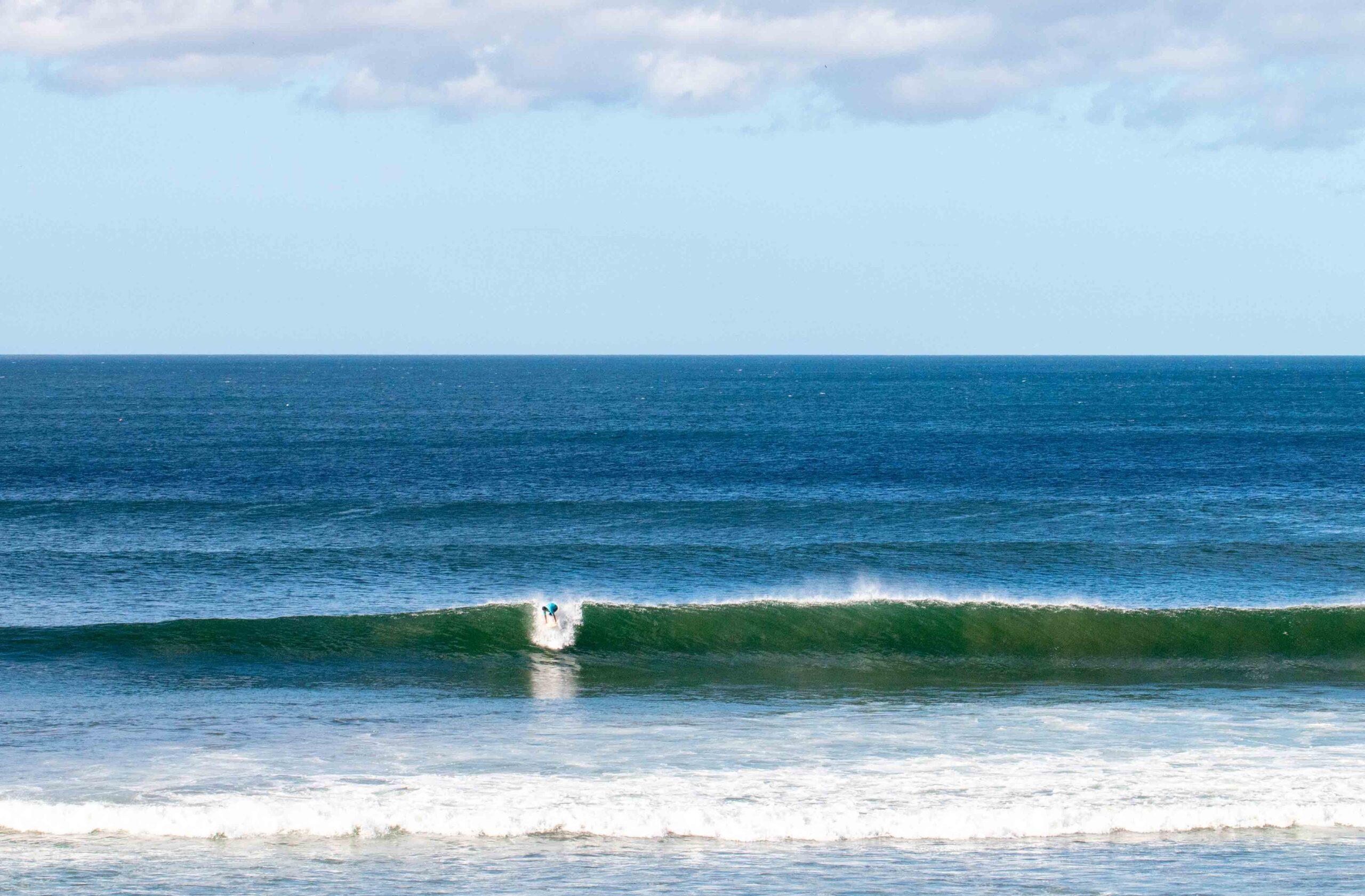 Surfer at Playa Popoyo Nicaragua