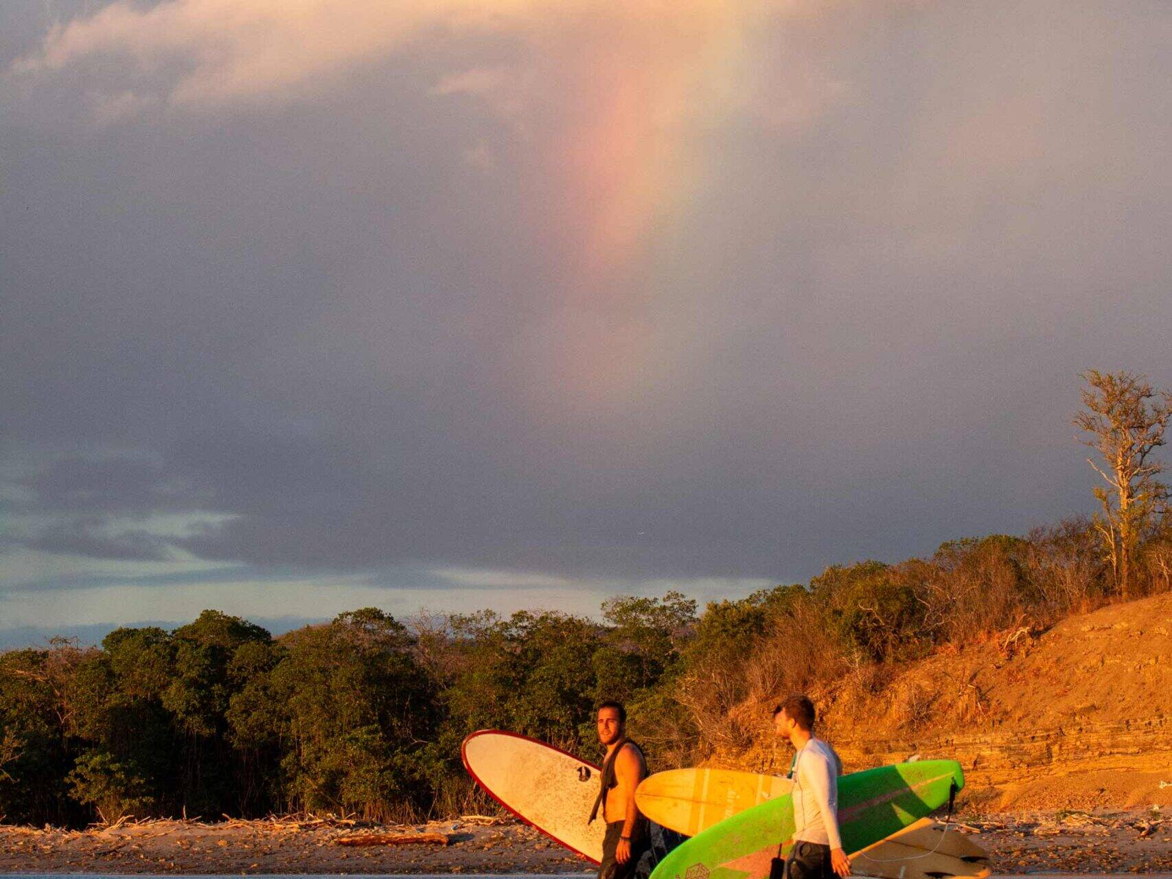 Surfers under the rainbow at Playa Popoyo Nicaragua