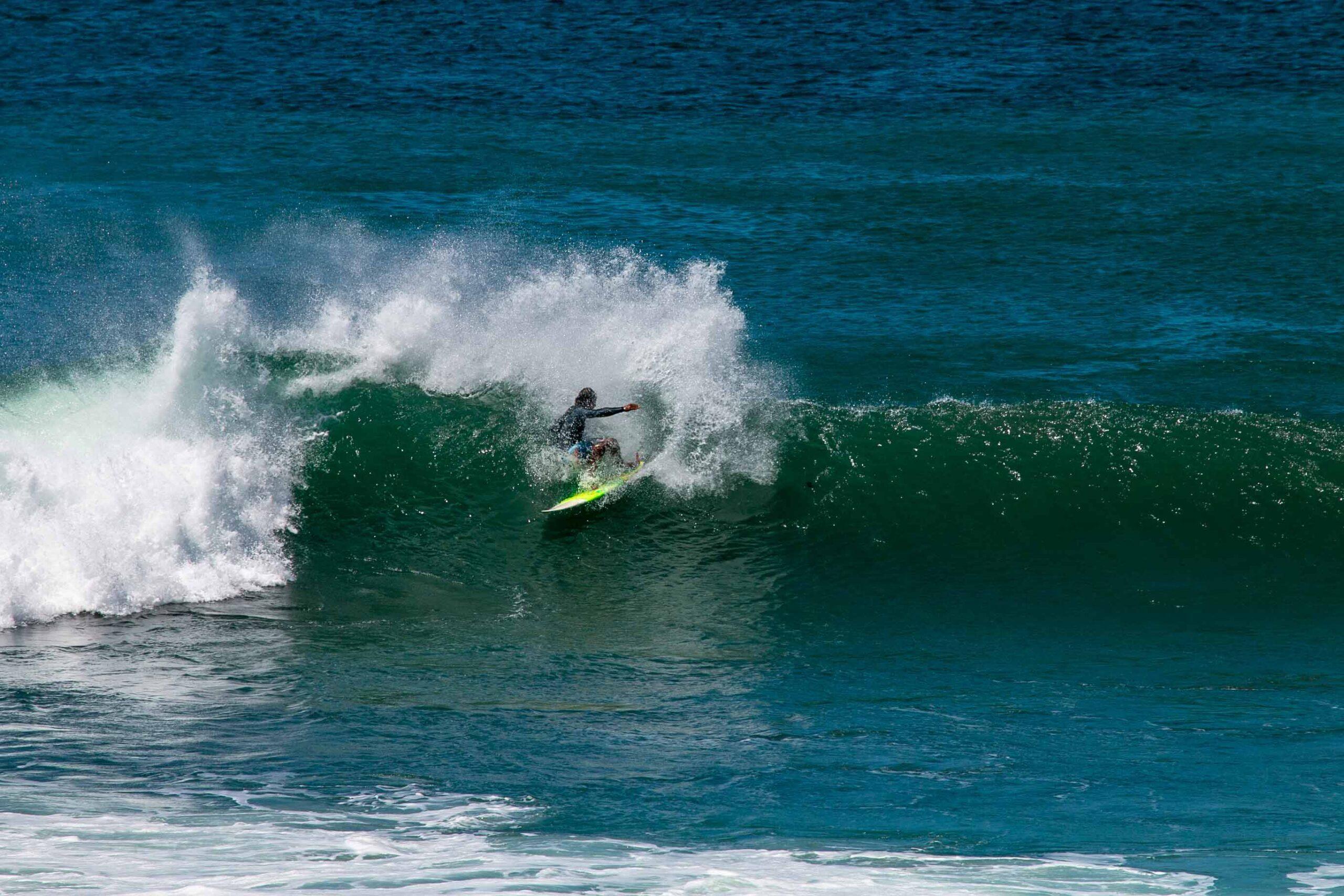 Surfer at Playa Colorado in Nicaragua
