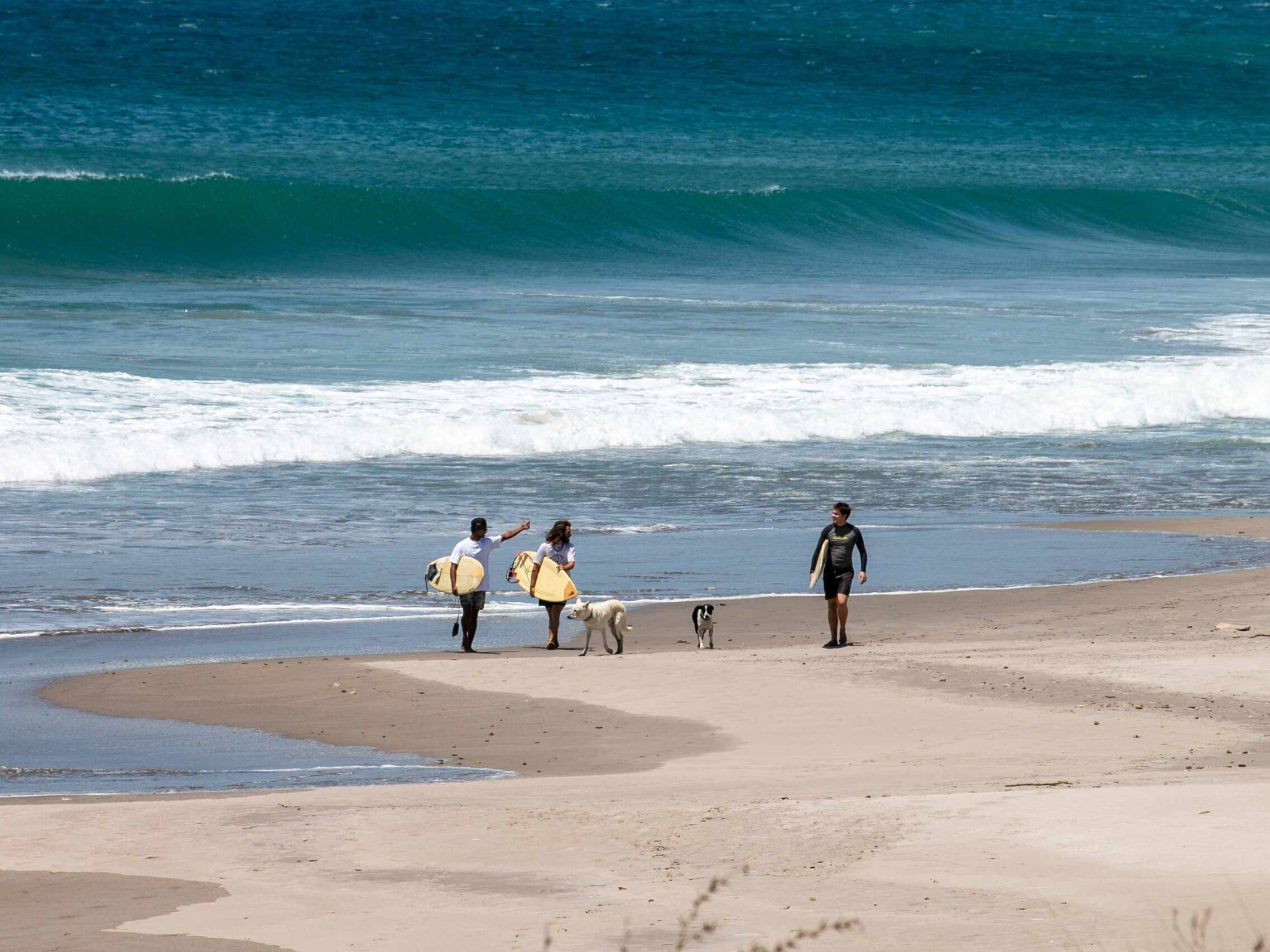 Surfers at Popoyo beach in Nicaragua