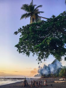 Bonfire on the beach during Mokum Surf Club retreat in Costa Rica