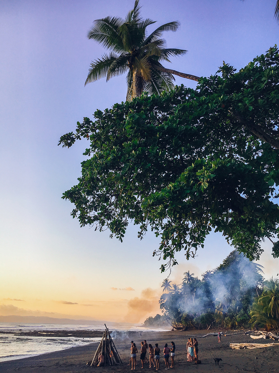 Bonfire on the beach during Mokum Surf Club retreat in Costa Rica