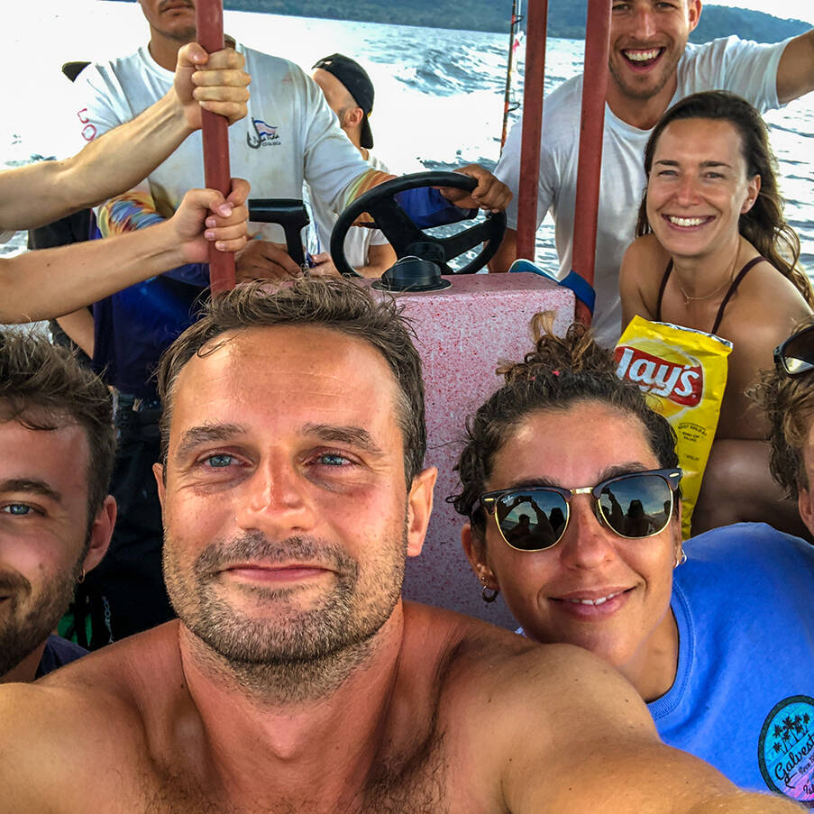 Mokum Surf Club retreat group on a boat trip in Costa Rica