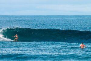 Surfer girl surfing Punta Banco wave in Costa Rica