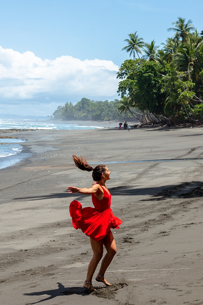 Dancing girl on the beach in Costa Rica