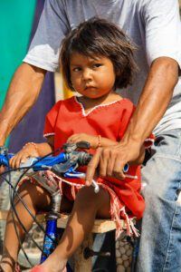 Girl on a bicycle in Colombia