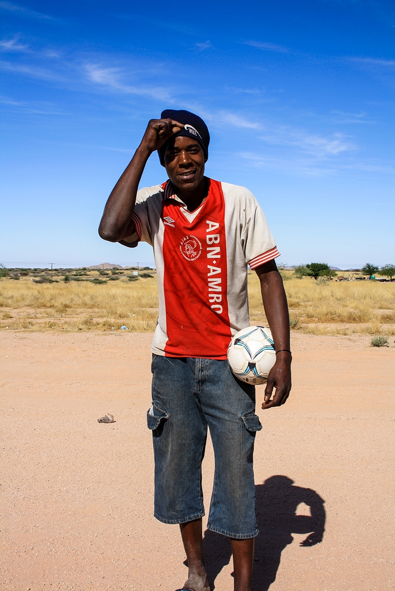 Man in Ajax shirt in the desert of Namibia
