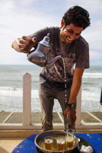 Man pouring mint tea in Essaouira Morocco