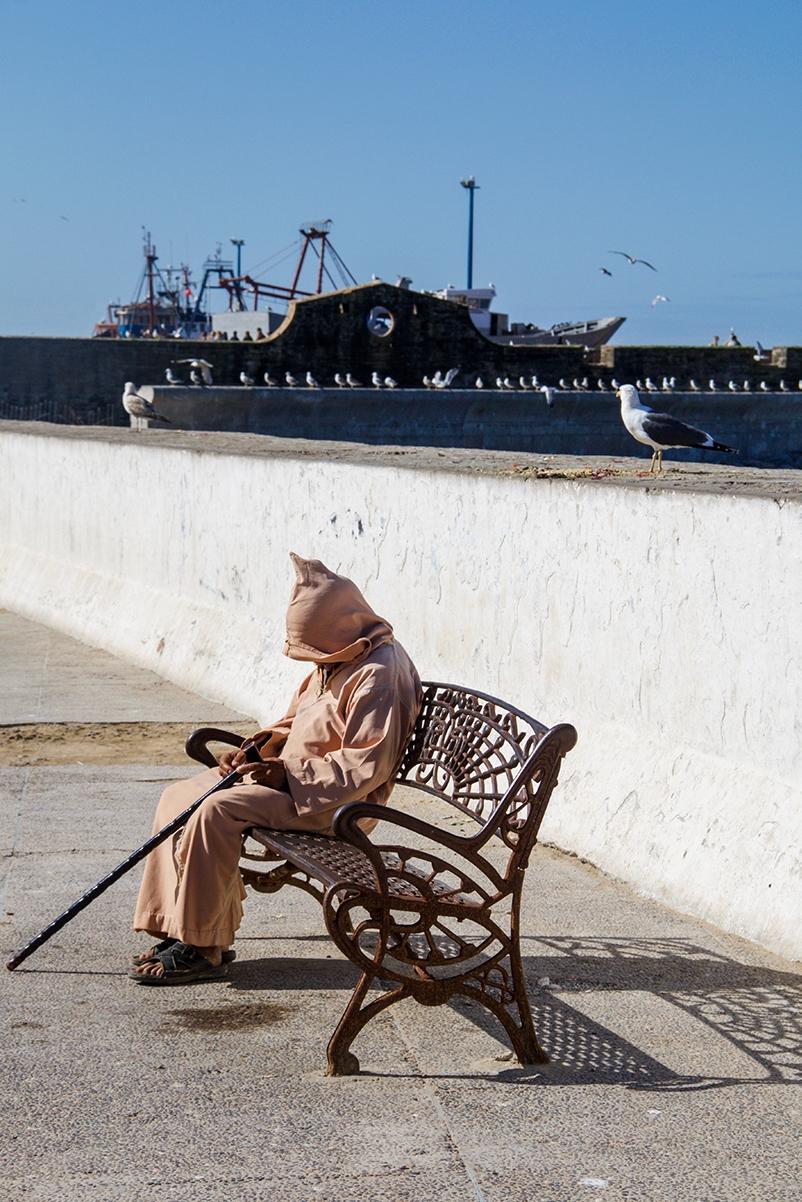 Man sleeping in the streets of Essaouira Morocco