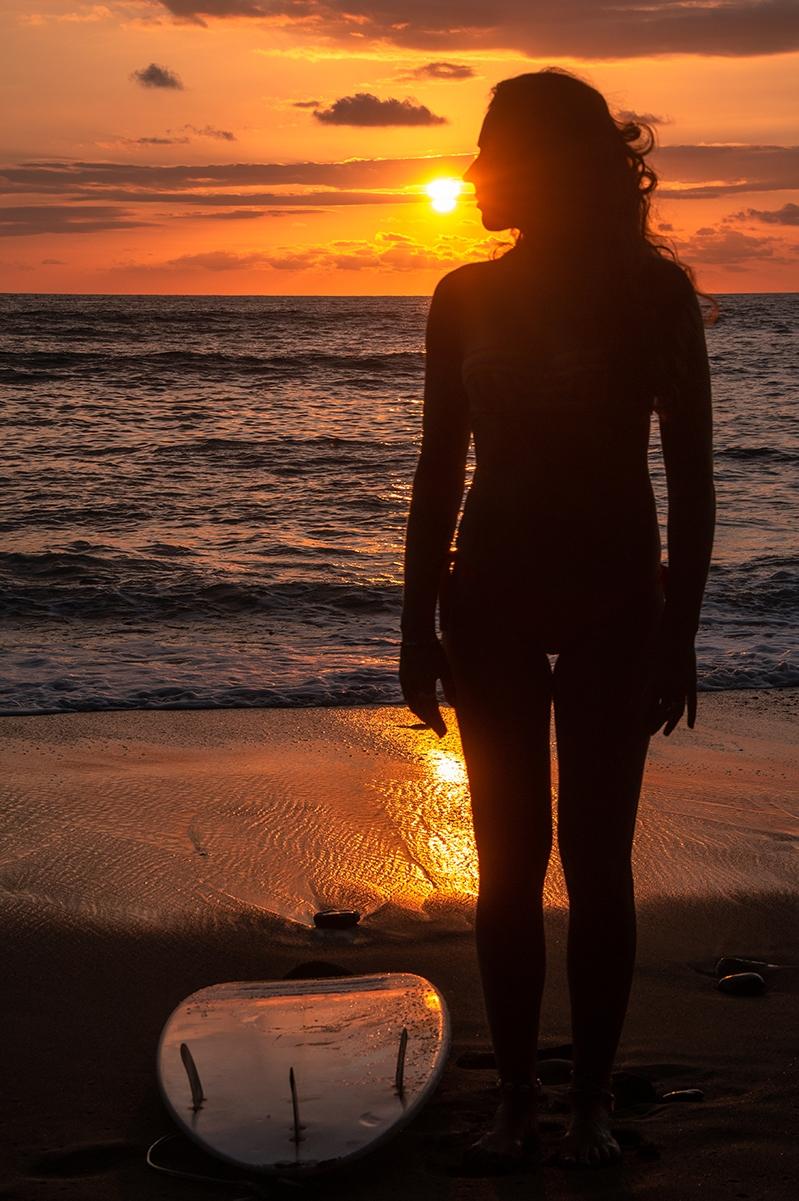 Surfer girl during sunset in Punta Banco Costa Rica