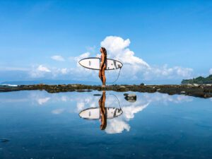 Reflection surfer girl in Punta Banco Costa Rica