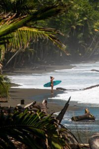 Surfer girl on Punta Banco beach in Costa Rica