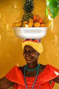 Woman with fruit basket in Cartagena Colombia