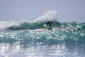 Surfer on a wave in Pavones Costa Rica