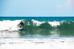 Surfer at Playa Cocles in the Caribbean Costa Rica