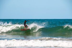 Surfer at Playa Cocles on the Caribbean Costa Rica